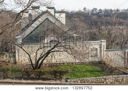 Private ownership of the stone fence. Architecture and attractions of the city of Kislovodsk.
