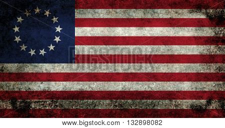 American thirteen point historic flag often named the Betsy Ross flag this version features dark grungy textures.