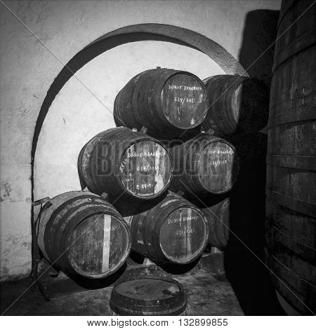 PORTO PORTUGAL - MAY 3 2015: Barrels or pipes of vintage port wine are stured under an arch in the cellar of the Ferriera port lodge to age in Porto Portugal.