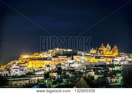 Night view of italian town of Ostuni in Puglia. Historical view of Italy