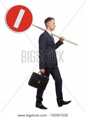 Official man carries a road sign, which means that no entry. Isolated on white background.