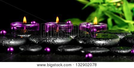 Spa Still Life Of Zen Basalt Stones With Drops, Lilac Candles, Beads And Bamboo, Closeup