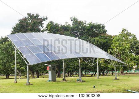 Solar panels on the green grass field