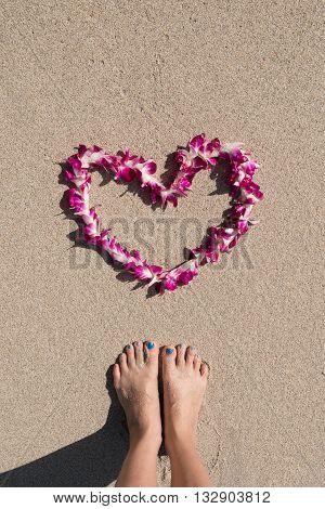 heart orchid flower garland white sea sand beach woman feet