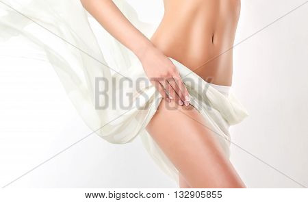 Slim tanned woman   Perfect Body  . Slim toned young body of the girl . An example for sports and fitness or plastic surgery and aesthetic cosmetology.