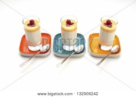 Side view of panna cotta shot glasses decorated with redcurrants. Party food on small colorful plates isolated on white.