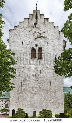 The old white norra vrams church in the swedish village of Billesholm.