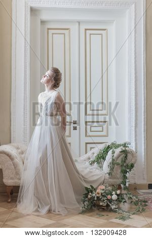 beautiful young girl bride in a beautiful airy dress in beige colors , wedding in the style of boho