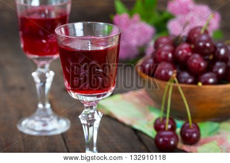 Crystal Glasses with cherry liquor. Selective focus.