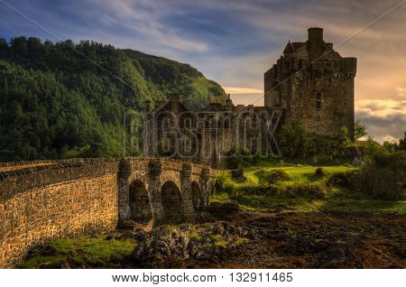Eilean Donan Castle and bridge in sunset light Highland Scotland