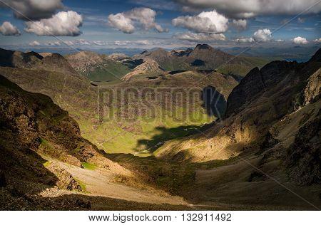 Peaks of Black Cuillins and Glen Coruisk in beautiful weather Isle of Skye Scotland