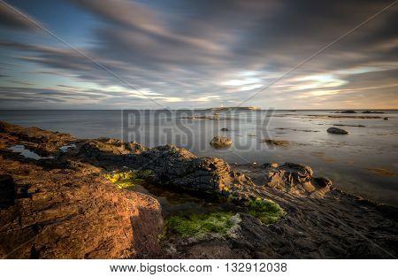 Pladda lighthouse with rocky coastline on sunset Isle of Arran Scotland