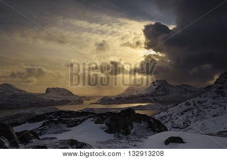 Stormy weather in Lofoten mountains in sunset light