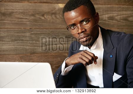 Close Up Portrait Of Handsome Successful African Corporate Worker In Formal Suit And Glasses, Lookin