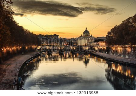 Rome, Italy: St. Peter's Basilica, Saint Angelo Bridge and Tiber River in the sunset
