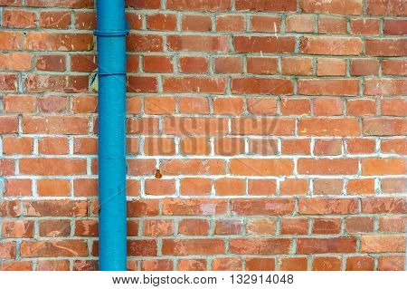 PVC pipe for water piping system resident on brick wall
