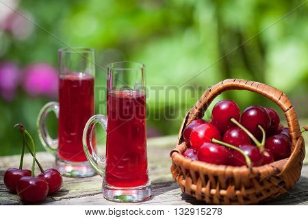 Maraschino liqueur with cherries in the basket
