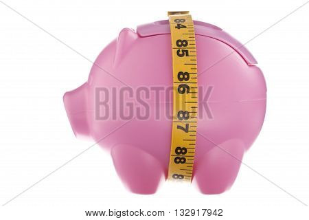 pink piggy bank with tape measure isolated on white background
