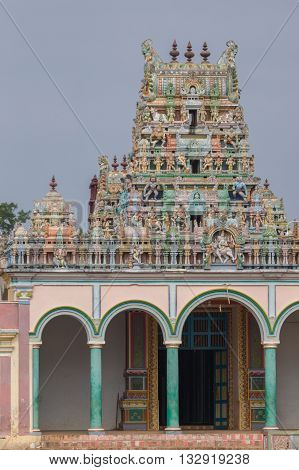 Chettinad India - October 17 2013: Highly decorated Vimanam towers over entrance to the Kothamangalam Shiva Temple.