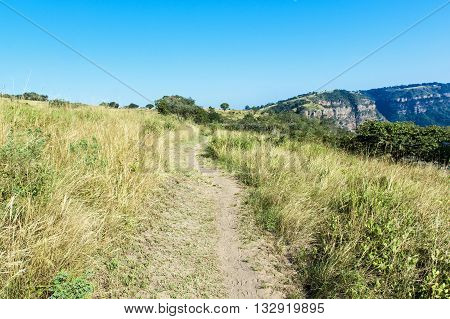 Empty Hiking Trail  Leading Towards  Distant  Rocky Cliff