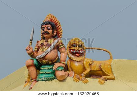 Chettinad India - October 17 2013: Statue of Ayyanar on the wall at Mariamman temple in Kothamargalam. He defends Lord Shiva and the village.