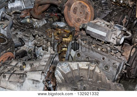 Scrapheap of old car engine and transmission