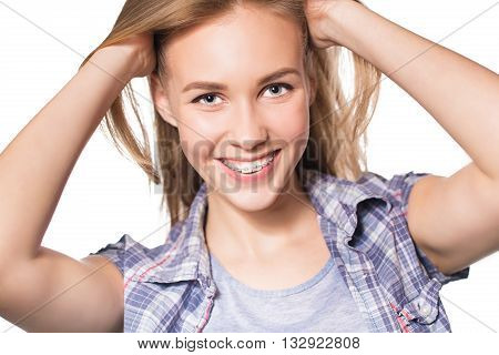 Close up portrait of smiling teen girl showing dental braces. Isolated on white background.