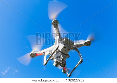 White Quadrocopter Flying In Blue Sky, Spy Drone