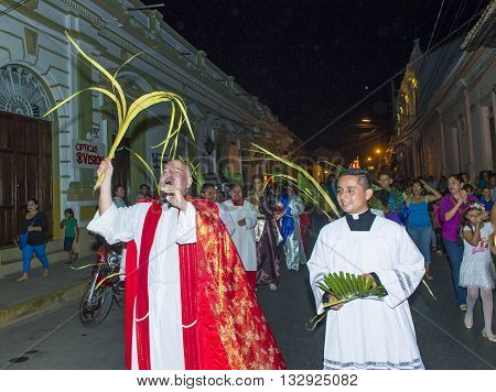GRANADA NICARAGUA - MARCH 20 : Unidentified Nicaraguan take part in the Palm sunday procession in Granada Nicaragua on March 20 2016. Palm sunday marks the beginning of the Holy week.