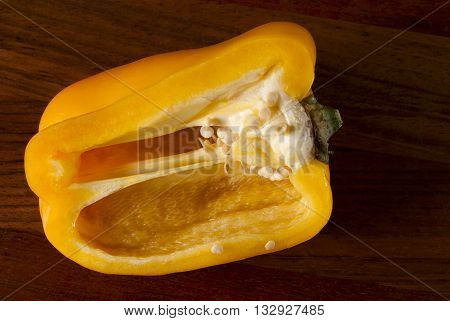 lying cut on a chopping Board pepper. Visible grains of pepper