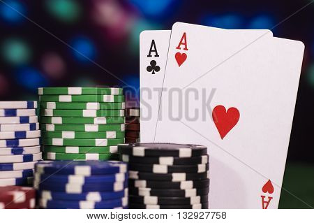 Two ace with a lot of poker chips (color background)