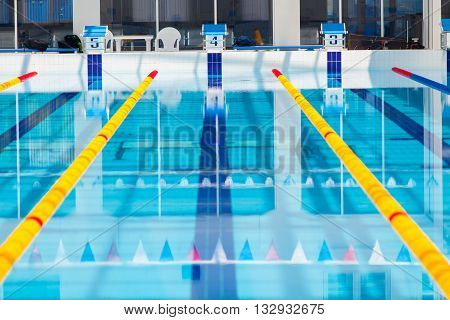 Lanes of a competition swimming pool, water