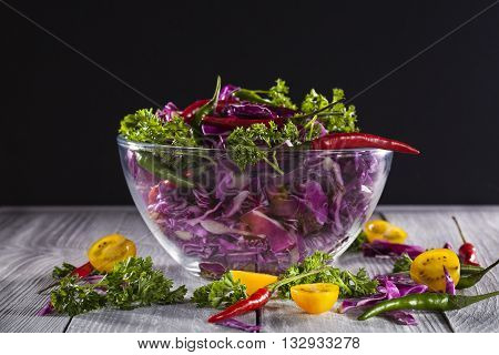 Salad with red cabbage, hot chili pepper and tomato cherry
