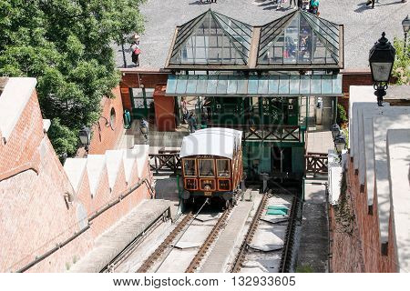 Budapest Hungary - 8 May 2016: Funicular full of people traverse a hill