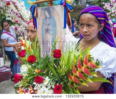PANCHIMALCO EL SALVADOR - MAY 08 : Salvadorian girls participate in the procession of the Flower & Palm Festival in Panchimalco El Salvador on May 08 2016
