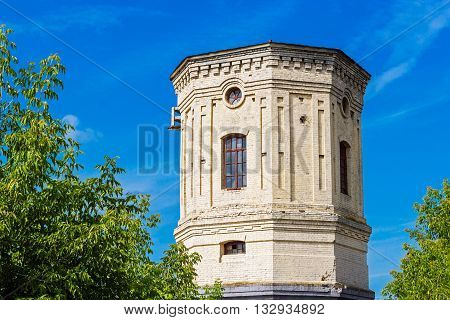 Old stone water tower on a summer day