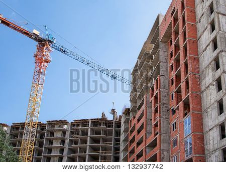 construction of new modern residential building on summer day