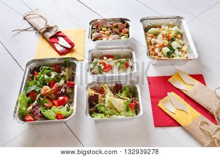Fitness food. Weight loss nutrition diet. Take away of healthy food. Eat right concept, diet, clean food take away in aluminium boxes, vegetable salads and meat at white wood. Healthy lunch
