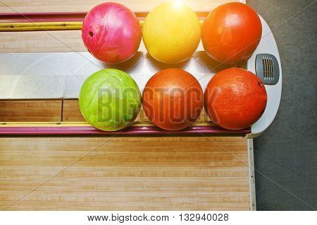 Top View Of Group Colored Bowling Balls At Bowl Lift