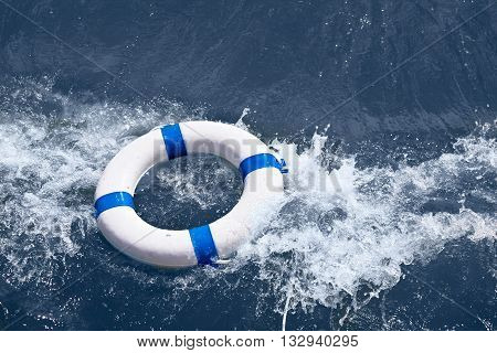 Lifebuoy lifebelt lifesaver in sea ocean storm as help in danger