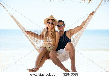 Beautiful Couple Relaxing In A Hammock