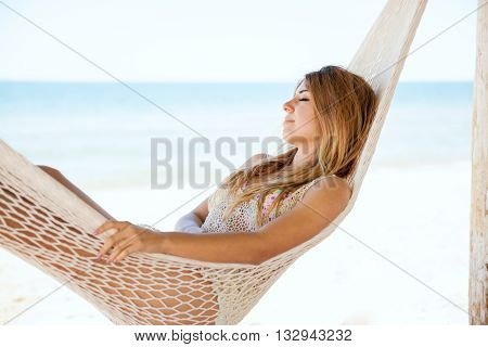 Beautiful Woman Relaxing In A Hammock