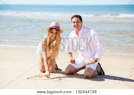 Couple Having Fun With The Sand