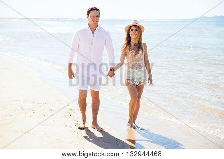 Cute Couple Walking Down The Beach
