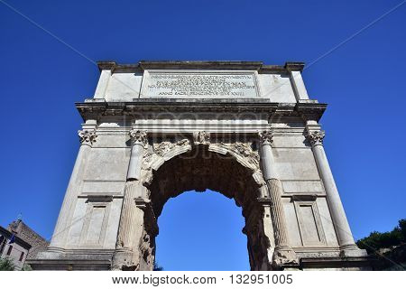 Ancient triumphal arch dedicated to Emperor Titus at the entrance of the Roman Forum (1st century A.D.)
