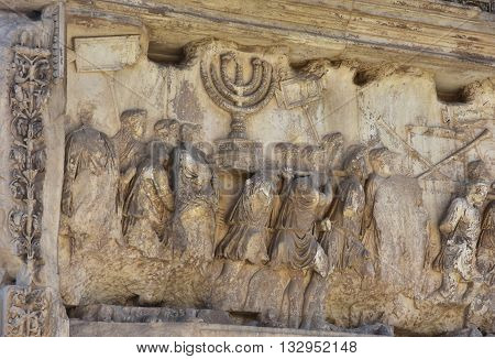 Arch of Titus panel relief with Menorah and other the spoils taken from the Temple of Jerusalem by the roman legion in 71 A.D.