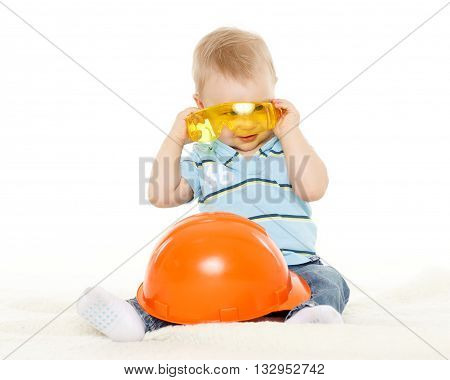 Baby With Helmet And Protective Glasses.