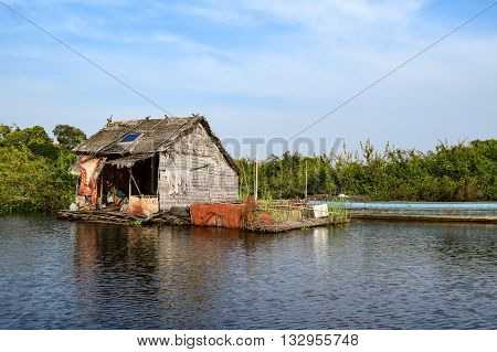 Floating village houses on Tonle Sap Lake in Cambodia. The houses are relocated a few times each year to gain optimal weather.  Transport is by small boats, some powered by man, some by mechanical means.