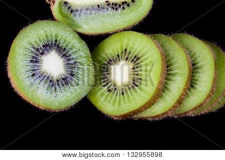 sliced Kiwi fruit isolated on black background cutout