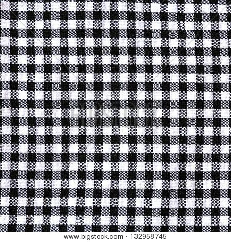 Black and white checkered tablecloth texture background with copy space